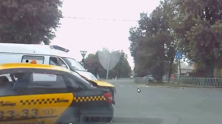 ambulance crashes into taxi
